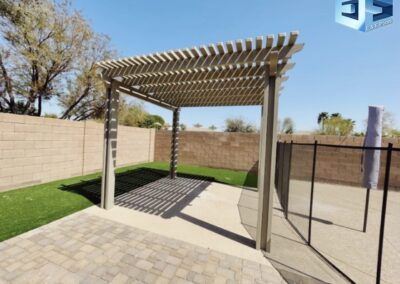 Pavers, Alumawood pergola artificial turf and a pool remodel We do it all