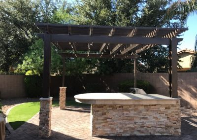 14' x 14' aluma wood Shade pergalla With 15' Bbq travertine and stacked stone Misting and lights(2)