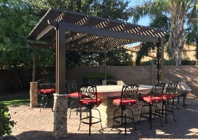 14' x 14' aluma wood Shade pergalla With 15' Bbq travertine and stacked stone Misting and lights(3)
