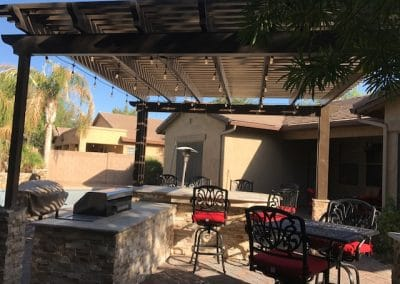 14' x 14' aluma wood Shade pergalla With 15' Bbq travertine and stacked stone Misting and lights