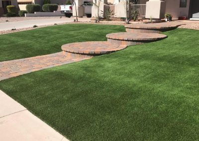 artifical turf and stone pathway
