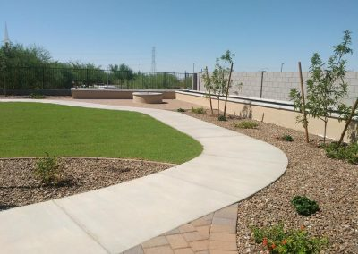 cement sidewalks turf and firepit with seating