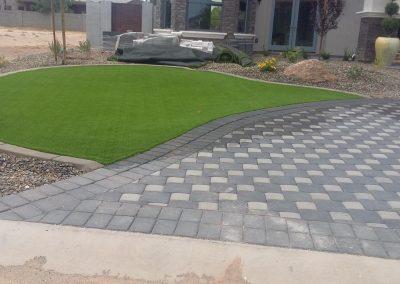 custom stone deck design and boardered turf