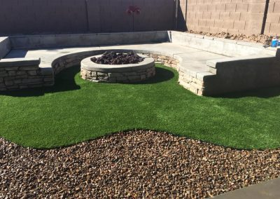 firepit with raised seating and artificial turf