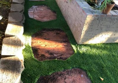 pathway artificial turf and stone slabs