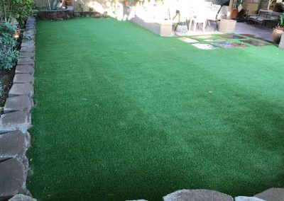 stone wall and artifical turf